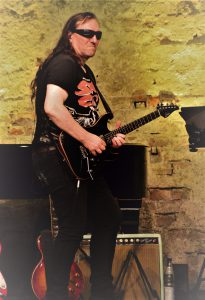 Herb Bucher (Ian Paice) – Guitar